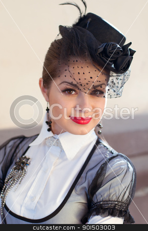 Portrait of a fresh and lovely woman wearing a hat with a veil stock photo, Portrait of a fresh and lovely woman wearing a hat with a veil and white blouse with a brooch on her breast by nvelichko