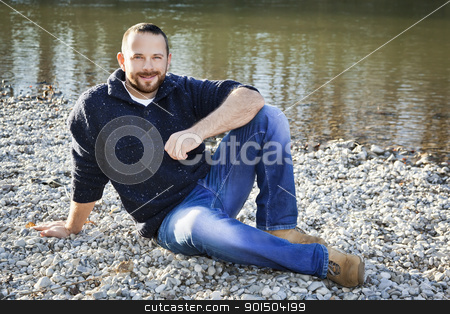 man with beard stock photo, A handsome man with a beard at the river by Markus Gann