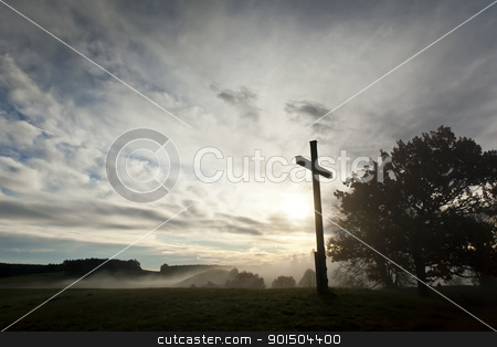 dramatic sky and a cross stock photo, An image of a dramatic sky and a cross by Markus Gann