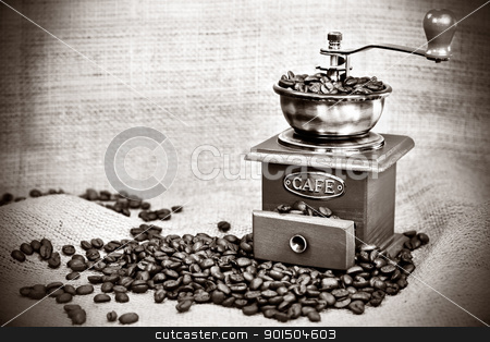 Vintage coffee mill stock photo, Contrast black&white image of vintage  coffee  mill or grinder with coffee beans .Dramatic lightning by borojoint