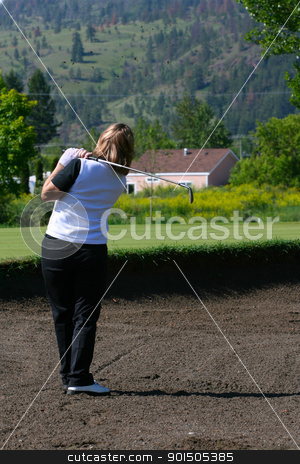 Bunker Shot stock photo, Adult female golfer playing a shot out of the bunker by Vanessa Van Rensburg