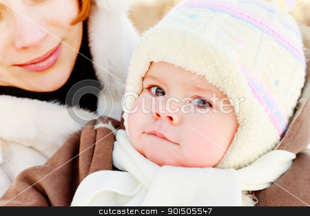 Mother with baby outdoor stock photo, Woman with baby on her hand in winter by Oleg