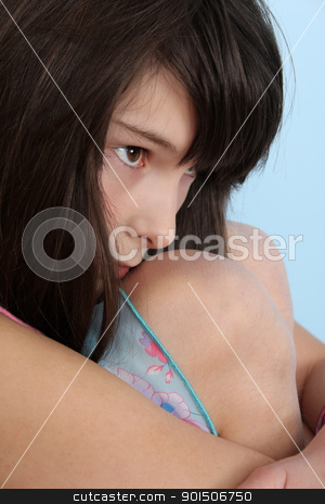 Lonely teen stock photo, Beautiful brunette teenager with her legs curled up against body by Vanessa Van Rensburg
