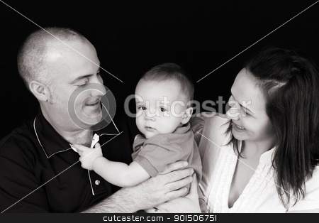 Family stock photo, Father holding his baby boy, mother looking on by Vanessa Van Rensburg
