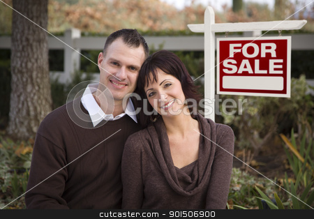 Happy Couple in Front of Real Estate Sign stock photo, Happy Attractive Caucasian Couple in Front of Real Estate Sign. by Andy Dean
