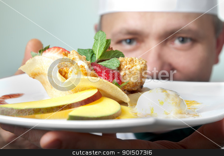 cheese fruit dessert stock photo, Chef holding a plate with fruit dessert, focus on dish by vilevi