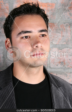 Male model stock photo, Male model against a rough brick wall background by ...