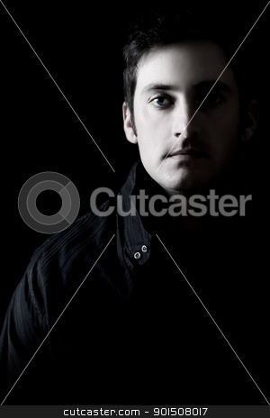 Dark male model stock photo, Attractive adult brunette male model against black background by Vanessa Van Rensburg