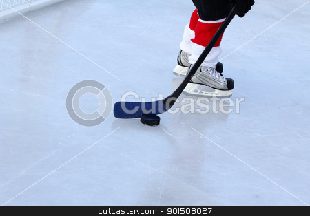 Pond Hockey stock photo, Young child playing ice hockey on a pond by Vanessa Van Rensburg