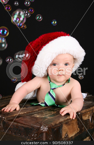 Christmas Bubbles stock photo, Cute christmas baby boy sitting on an antique trunk  by Vanessa Van Rensburg