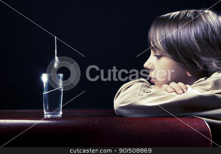 Physics stock photo, The boy bends the laws of physics. by nowoka1na