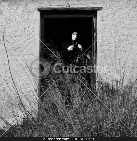 masked figure by broken door stock photo, Masked figure by broken door of abandoned house obscured by overgrown plants. by sirylok