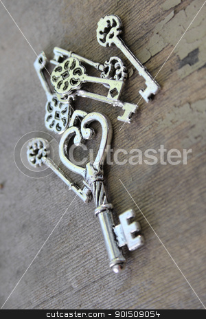 Miniature keys stock photo, Miniature antique keys on a wooden surface by Vanessa Van Rensburg