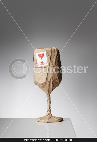 Fragile stock photo, An obviously fragile object wrapped in paper and with a