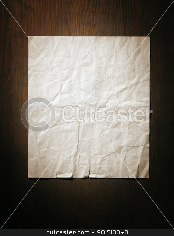 Old Paper stock photo, Old crumpled and torn paper on wooden background. by Stocksnapper