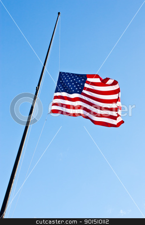 Half staff American flag stock photo, American flag on a blue sky during a windy day by Perseomedusa