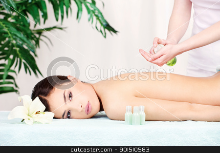 back massage stock photo, Lovely lady getting a back massage by iMarin