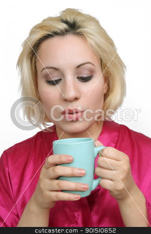 Beautiful Blonde with Coffee (2) stock photo, A lovely young blonde with a captivating smile, wearing a bathrobe and about to take a sip of coffee. by Carl Stewart