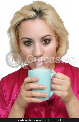 Beautiful Blonde with Coffee (3) stock photo, A lovely young blonde with a captivating smile, wearing a bathrobe and about to take a sip of coffee. by Carl Stewart