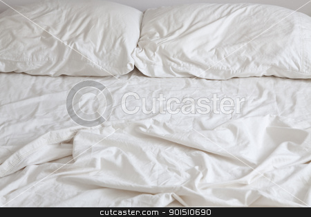 Empty Bed stock photo, Empty bed with disheveled pillows and sheets by Bryan Mullennix