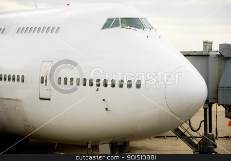 Plane in airport stock photo, Air travel - A parked plane in an airport by Lars Christensen