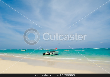 Beach and boats stock photo, Exotic beach with white sand. In the water you can see some boats. Dominican Republic, Punta Cana. by Lars Christensen