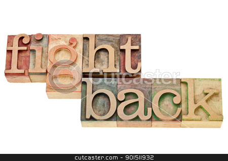 fight back - motivation concept stock photo, fight back - motivation concept - isolated words in vintage wood letterpress printing blocks by Marek Uliasz