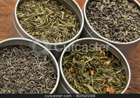 green tea samples stock photo, four organic green tea samples in metal cans against grunge wood table by Marek Uliasz