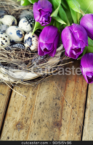 easter eggs with purple tulip flowers stock photo, easter eggs with purple tulip flowers  on wooden board by klenova