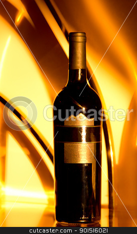 The golden wine bottle stock photo, A wine bottle with a dreamy golden background lit by the rising morning sun by derejeb