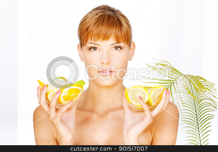 girl with two bowl full of fruit stock photo, Portrait of a pretty brunette girl with two bowl full of fruit in her hands in a spa salon by iMarin