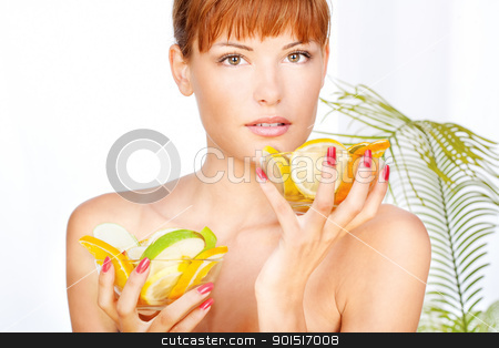 girl in a wellness salon stock photo, Portrait of a girl in a wellness salon holding two bowls full with fruits, looking at the camera by iMarin