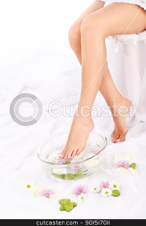 Slim legs of beautiful girl stock photo, Slim legs of beautiful girl with aromatherapy bowl  by iMarin