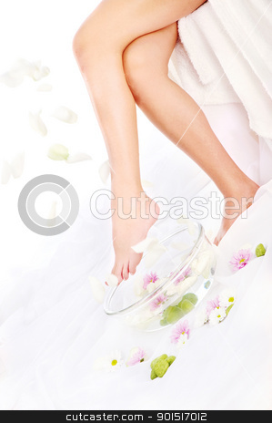 falling petals stock photo, Legs of beautiful girl with aromatherapy bowl and falling petals by iMarin