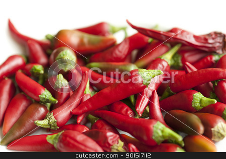 Red Hot Chilli stock photo, An abstract background of lots of whole red chillies by Stephen Gibson