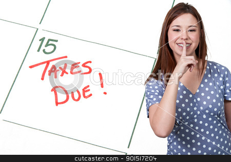 Woman Taxes Due stock photo, Woman and calendar reminder that Taxes are Due by Robert Byron