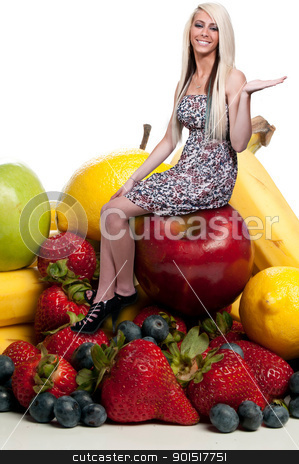 Woman with Fruit Smoothie stock photo, Beautiful woman sitting with a delicious assortment of fruit by Robert Byron