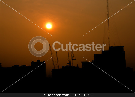 Construction at sunrise silhouette stock photo, City under construction at sunrise silhouette by stoonn