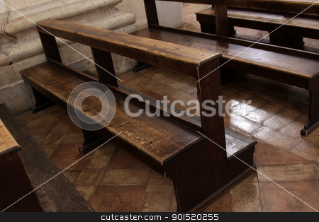Well Used Church Pews stock photo, Worn Church pews in a basilica in Italy. by Chris Hill