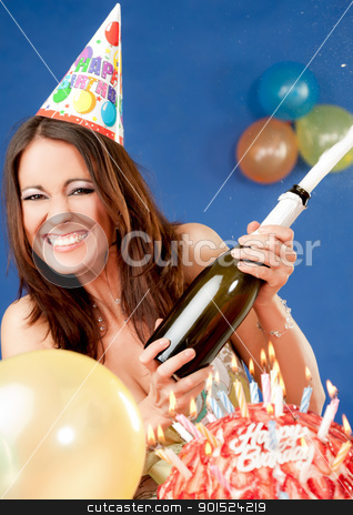 excited female birthday champagne stock photo, Happy excited female with party hat sitting behind birthday cake, popping up champagne by vilevi