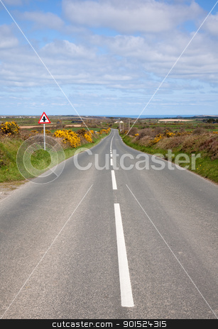 English country road with the sea on the horizon. stock photo, English country road with the sea on the horizon. by Stephen Rees