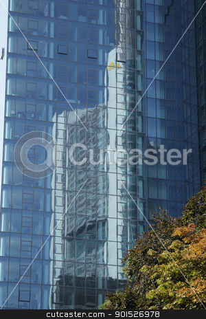 Skyscraper Reflections stock photo, Modern skyscraper seen as a reflection in the glass walls of an office building in Frankfurt, Germany. by DirkR