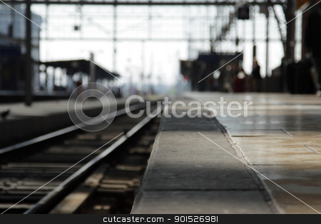 Railway platform stock photo, Empty railway platform, focus on the foreground. by DirkR