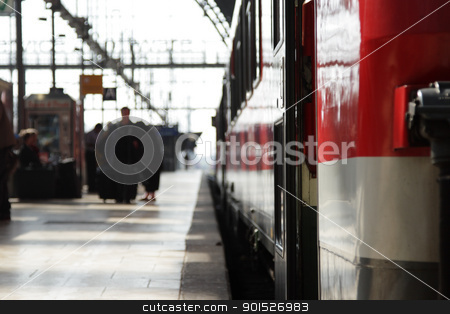 Train Station stock photo, Travelers on a railway platform, focus on the foreground. by DirkR