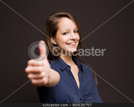 All O.K.! stock photo, Gorgeous happy young brunette woman showing thumbs up. by exvivo