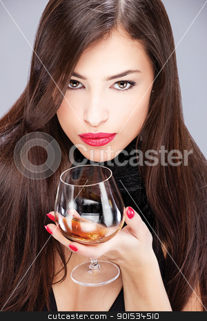 woman with pelt holding glass of brandy stock photo, Portrait of a pretty woman with pelt, holding glass of brandy by iMarin