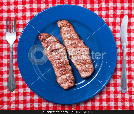 Argentinian meat. stock photo, Argentinian grilled meat on blue plate. by Pablo Caridad