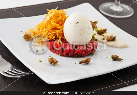 Gourmet dish with egg and raw meat.  stock photo, Gourmet dish with egg and raw meat. Studio shot.  by Pablo Caridad
