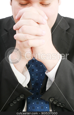 portrait of businessman praying for success  stock photo, portrait of businessman praying for success   by dacasdo
