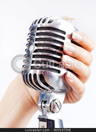 Big retro microphone in woman's hand stock photo, Big retro microphone in woman's hand by iMarin